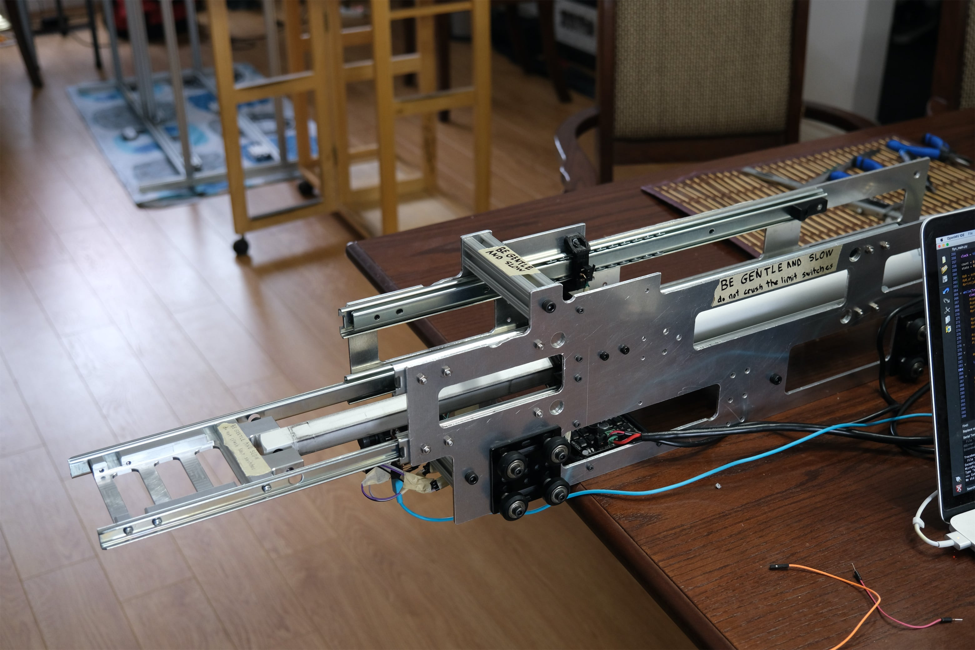 Linear actuator, mounted to Flyn with end effector visible.